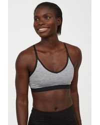 947aabcc96 Lyst - H M Sports Bra Low Support in White