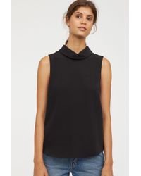 e578af6122b66 Lyst - H M Sleeveless Blouse in Black