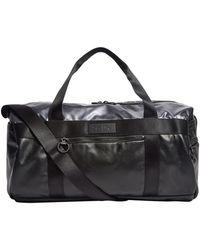Lyst - PUMA Fenty By Rihanna Padded Barrel Bag in Metallic 75bf30ce6dd88