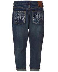 43a976bf89fd Evisu Carrot-fit Denim Jeans With Gold Brushstroke Logo Embroidery ...