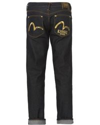 46be42078105 Evisu Slim-fit Denim Jeans With Arrow Print in Black for Men - Lyst
