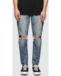 Denim by Vanquish & Fragment - Knees Crash Tapered Denim Jeans - Lyst