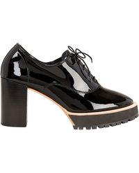 e51a5235dd2a Lyst - Prada Patent Brogue Slingback Oxford in Black