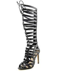 a3e3e3950d4 Lyst - Vince Camuto Olivian Tall Lace-Up Gladiator Sandals in Brown