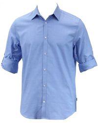 Calvin Klein - Non-iron Solid Blue Yd Oxford Button Up Dress Shirt - Lyst