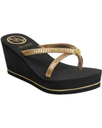 0c0f18746b0 Lyst - Guess Women s Eaves Wedge Flip-flop Thong Sandals in Black