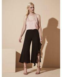 Krisa - Asymmetrical Crop Ruffle Pant - Lyst