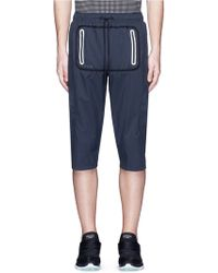 Dyne - Reflective Trim Cropped Jogging Pants - Lyst