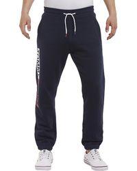 Tommy Hilfiger - Pantalón de jogging de felpa 100% algodón con logotipo lateral - Lyst