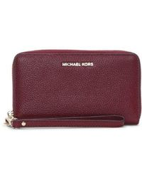 76162daf9fde Michael Kors - Maroon Leather Wristlet Smartphone Case Wallet - Lyst