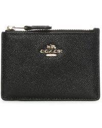 3e85fd182b7e Lyst - COACH Metallic Mini Id Skinny Wallet in Purple
