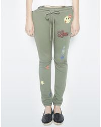 a3d0ace57 ASOS Hello Kitty X Bow joggers With Tape Detail in Black - Lyst