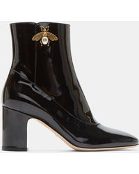 Gucci - Gold Bee Motif Patent Ankle Boots In Black - Lyst