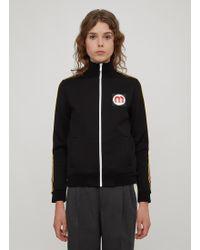 8071e2de0cf9 Miu Miu - Striped Rubber Logo Patch Track Top In Black - Lyst