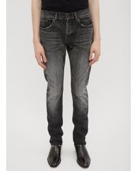 Saint Laurent - Raw Cut Black Washed Jeans In Black - Lyst