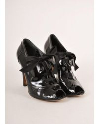 Boutique Moschino | Black Patent Leather Peep Toe Laced Kilty Booties | Lyst