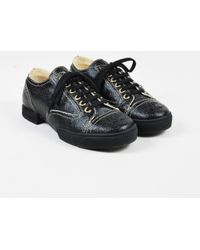 Chanel - Black Coated Canvas Lace Up 'cc' Cap Toe Sneakers Sz 37 - Lyst