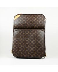 """Louis Vuitton - """"pegase 50"""" Monogram Coated Canvas Suitcase - Lyst"""