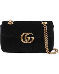 8d74688c5aff4 Lyst - Gucci GG Marmont Mini Matelassé Leather Cross-Body Bag in Black