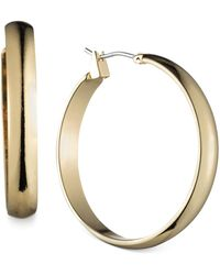 "Anne Klein - Gold-tone 1 1/4""wide Hoop Earrings - Lyst"