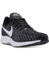 cb9e88bd34e02 Lyst - Nike Men S Free Flyknit 4.0 Running Sneakers From Finish Line ...