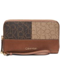 1a010ef14f4f Calvin Klein - Key Item Monogram Large Zip Around Wallet - Lyst