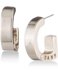DKNY - Logo Huggie Hoop Earrings - Lyst