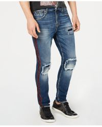 Guess - Utility Fit Ripped Jeans - Lyst
