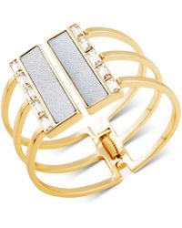 Guess - Gold-tone Crystal & White Faux Leather Hinged Cuff Bracelet - Lyst