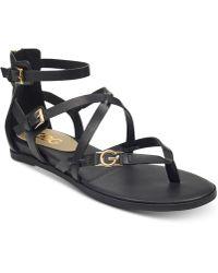 d22dc8b797f5 Lyst - G by Guess Gold Jumper Logo Thong Sandals in Metallic