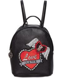 32e9e3ce1d4 Lyst - Betsey Johnson Love Turn Embellished Backpack in Black