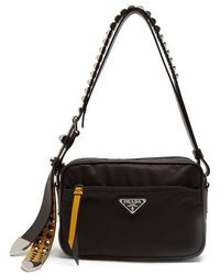 Prada - Stud-embellished Strap Nylon Cross-body Bag - Lyst