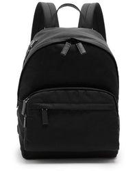 Prada - Logo-appliqué Leather-trimmed Backpack - Lyst