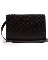 Gucci - Gg-debossed Leather Cross-body Bag - Lyst