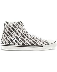Vetements - All-over Logo Print Cotton Canvas Sneakers - Lyst