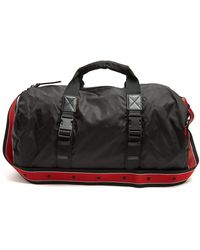 Givenchy - Leather-trimmed Nylon Holdall - Lyst