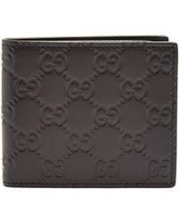 Gucci - Gg Debossed Bi Fold Leather Wallet - Lyst