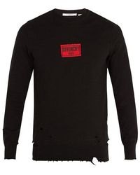 Givenchy - Distressed Cotton-blend Sweatshirt - Lyst