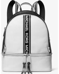 f5daf449da99 Lyst - Michael Kors Rhea Mini Perforated Leather Backpack in Red