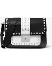 ba7cf50bc325 MICHAEL Michael Kors - Sloan Editor Studded Two-tone Leather Shoulder Bag -  Lyst