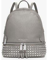 1895615b3a30 Michael Kors Rhea Zip Small Studded Leather Backpack in Metallic - Lyst