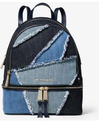 80ed3e5f55be Michael Kors Rhea Medium Mosaic Patchwork Denim Backpack in Blue - Lyst