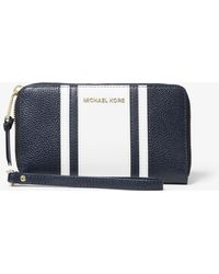 Michael Kors - Large Striped Pebbled Leather Smartphone Wristlet - Lyst