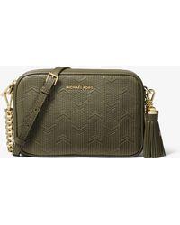 65d195ab8e80 Michael Kors Ginny Medium Love Embellished Leather Crossbody Bag in ...