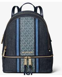 3b7e71c626e576 MICHAEL Michael Kors Rhea Medium Frayed Denim Backpack in Blue ...