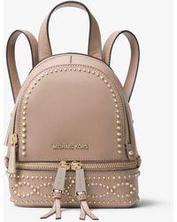 b669b2c69e98 Lyst - Michael Michael Kors Rhea Small Leather Backpack in Purple