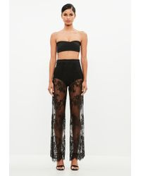 Missguided - Peace + Love Black Lace Flare Leg Trousers - Lyst