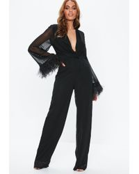 6295dbcaac5b Lyst - Missguided Black Harness Lace Long Sleeve Jumpsuit in Black