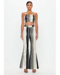 0df80f26c1a Missguided - Peace + Love silver Metallic Stripe Flared Trousers - Lyst
