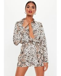 6d0cc0dca2 Missguided - Brown Snakeprint Long Sleeve Utility Playsuit - Lyst